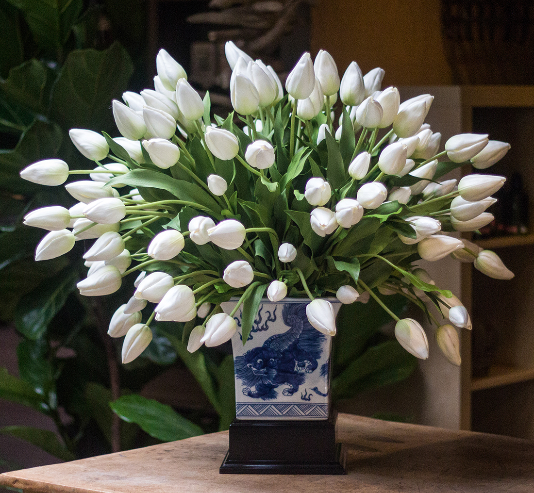 An image of a white tulip custom silk arrangement