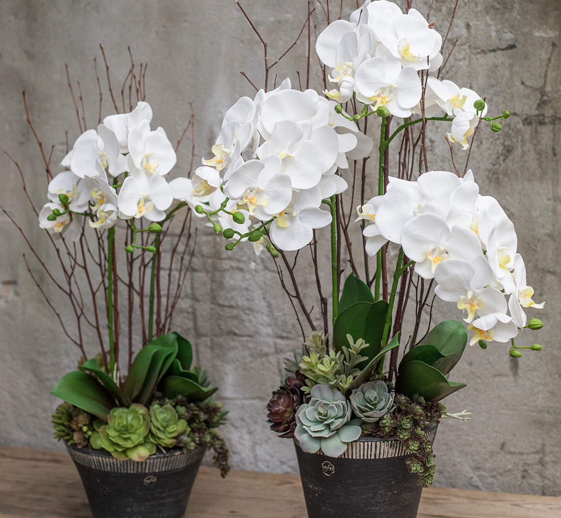 An image of two custom silk white orchids
