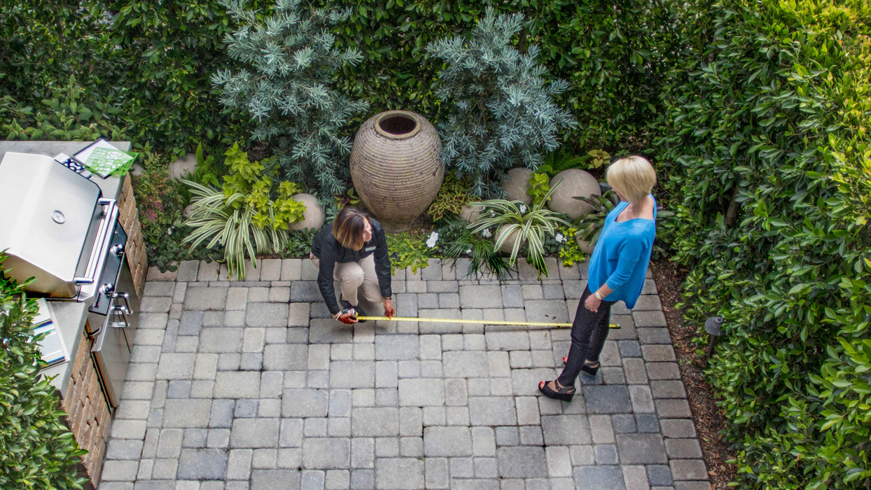 An image of a outdoor living consultant helping a customer