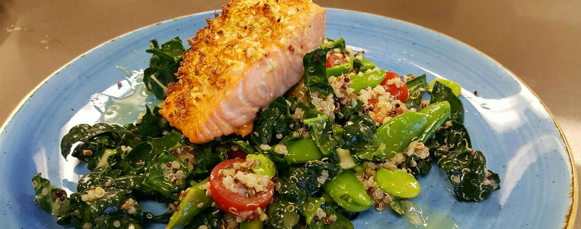 An image of a salmon dish with spring vegetables and Quinoa Salad