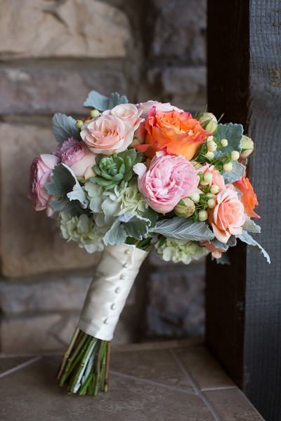 An image of pink and orange flower wedding bouquet