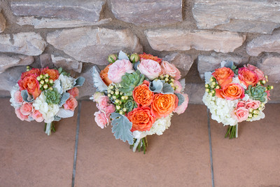 An image of the orange and pink rose floral centerpiece for the Cortez Wedding
