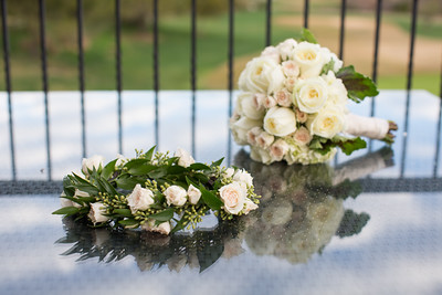 An image of a white rose bouquet and wreath from the Lim wedding