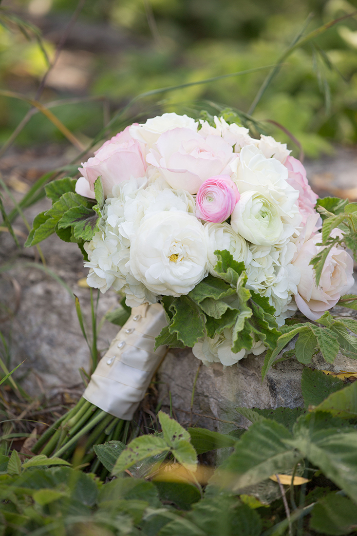An image of a white and light pink rose bouquet from the Barlow Wedding
