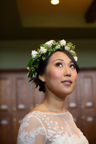 An image of the lovely Mrs. Lim wearing a white rose garland crown