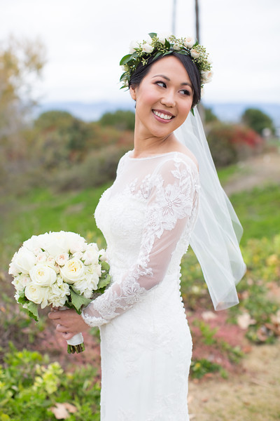 An image of the beautiful Mrs. Lim wearing a white rose crown and holding a white rose bouquet