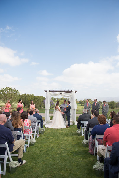An image of the bride and groom at the alter of the Cortez Wedding