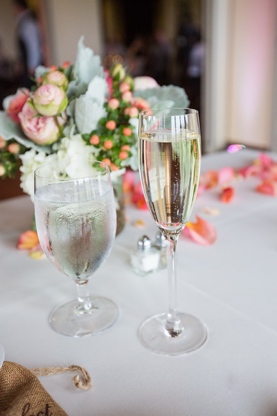 An image of a glass of water and a glass os champagne