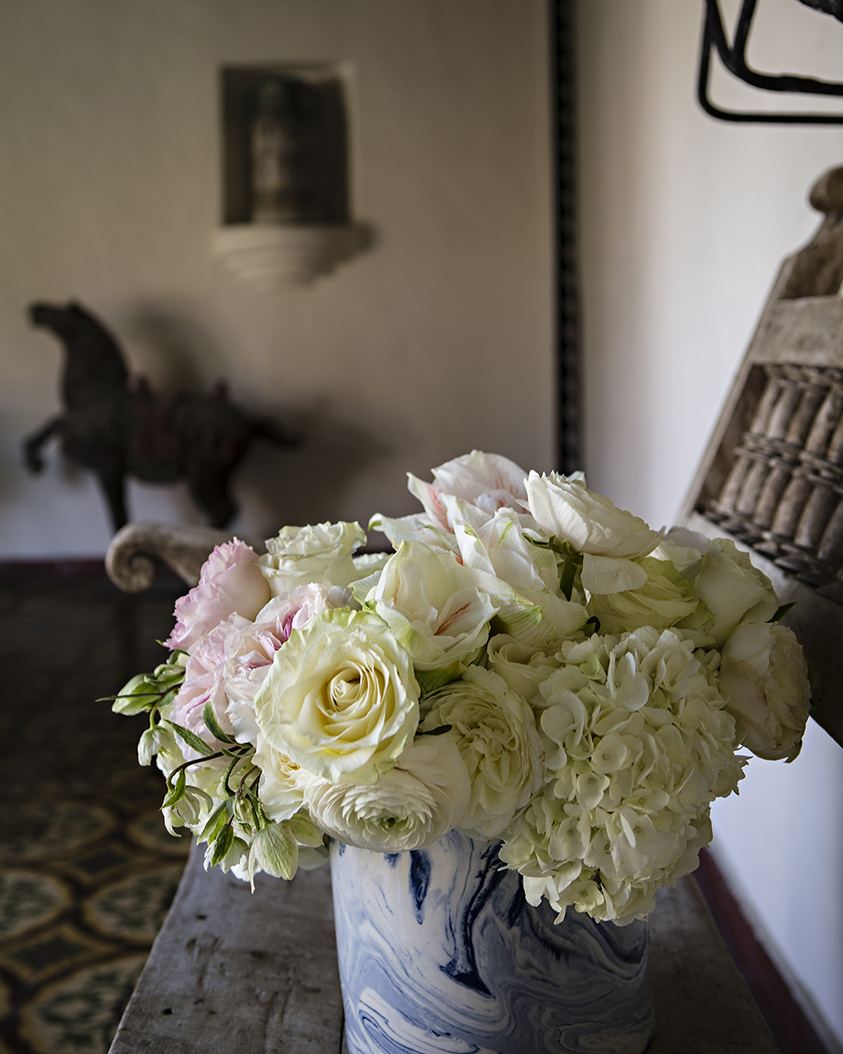 An image of a white and light pink rose and white hydrangea floral arrangement from the Dunzer Wedding