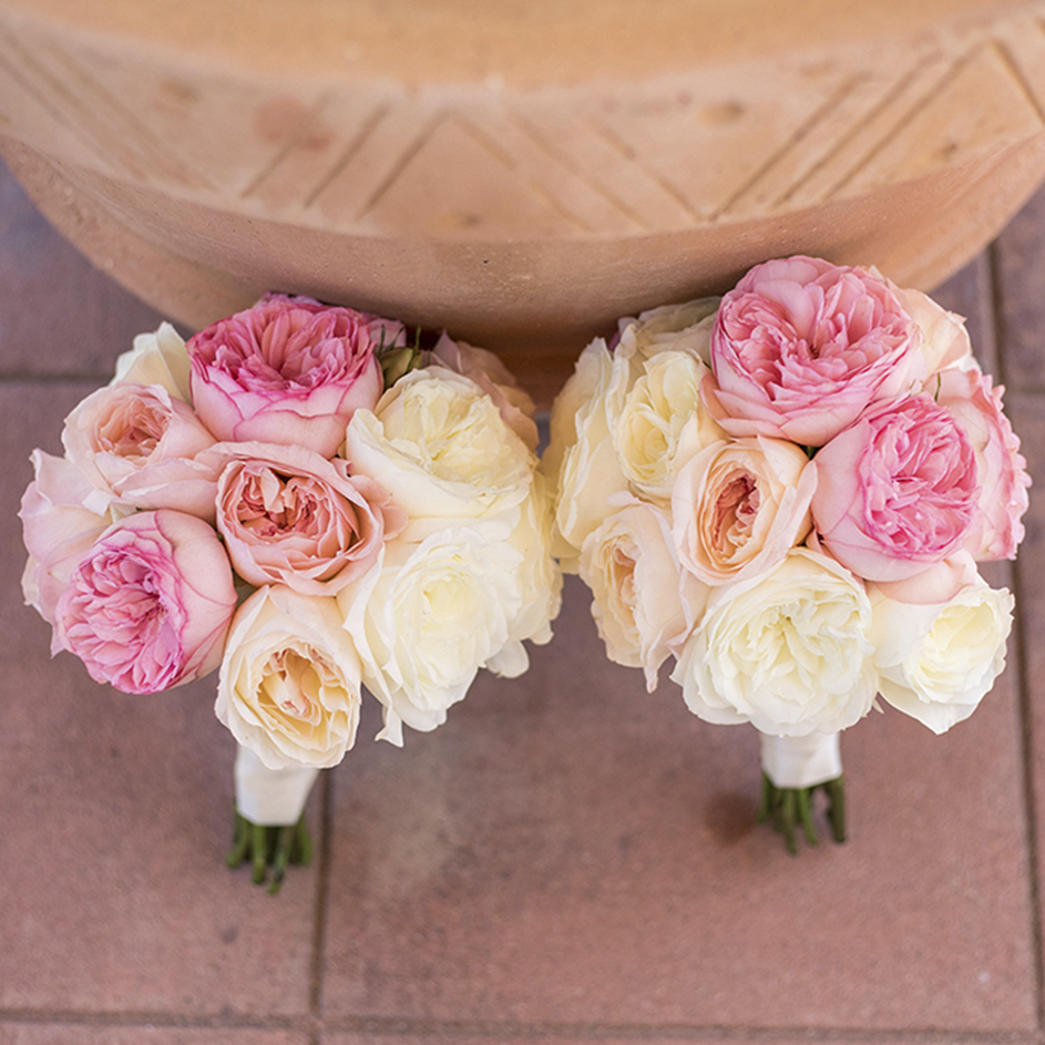 An image of light pink and white rose floral bouquets for the Dunzer Wedding