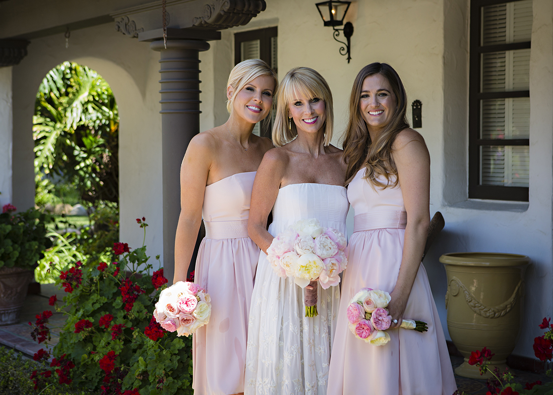 Am image of two bridesmaids and the bride at the Dunzer wedding