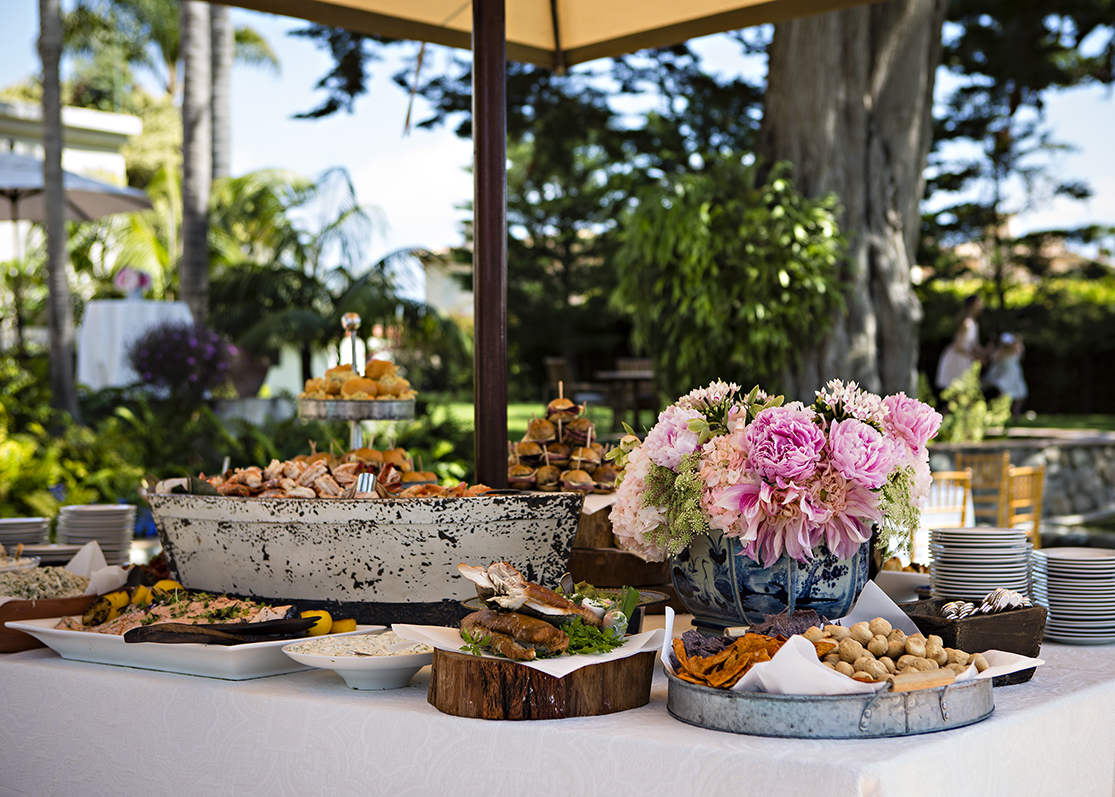 An image of one of the tables filled with delicious food from the Dunzer Wedding