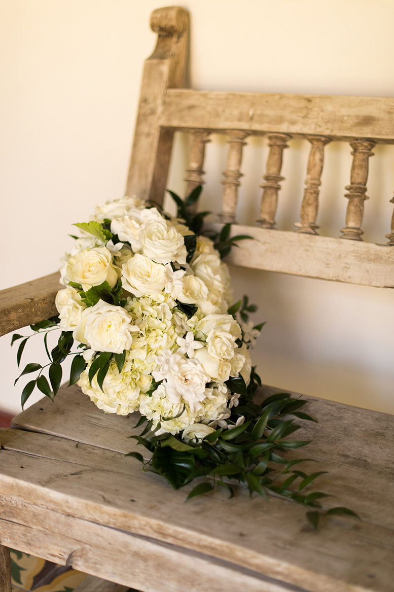An image of white roses, hydrangea and gardenia wedding bouquet