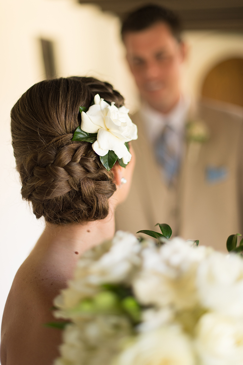 An image of the lovely bride wearing a gardenia in her braided hair
