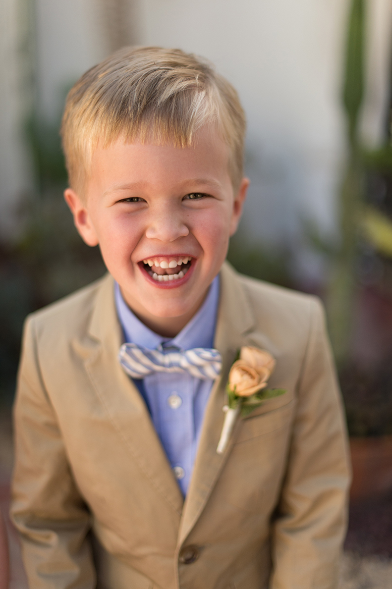 An image of a young boy smiling from the Premoli-Herbert Wedding