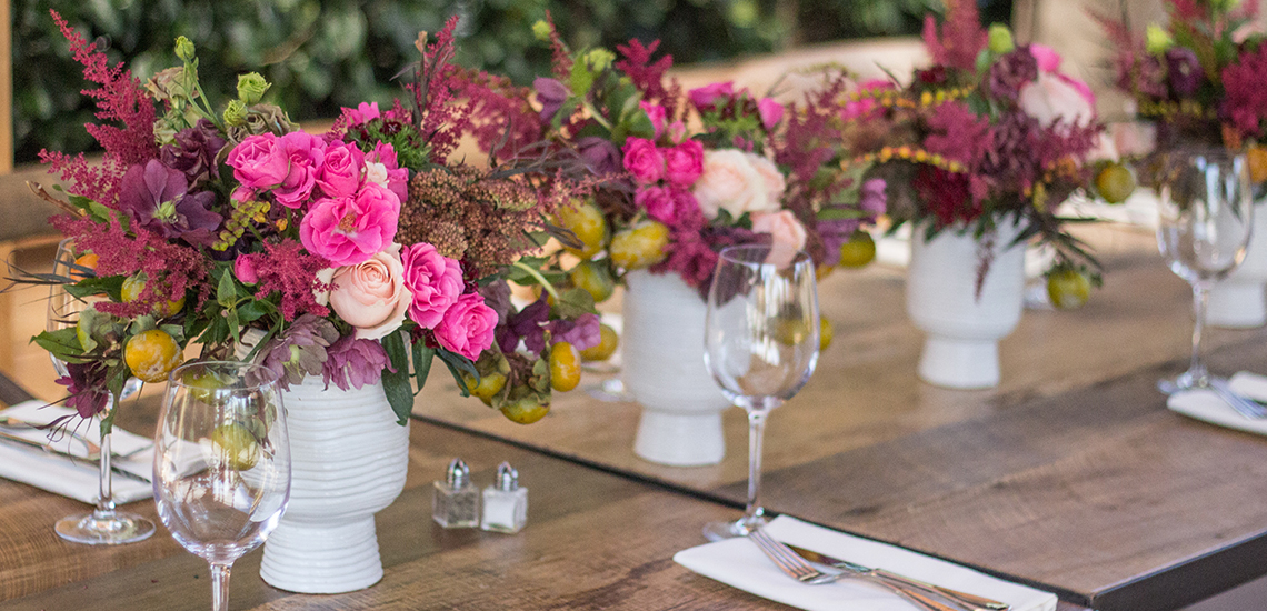 An image of light pink and pink rose floral arrangements for events