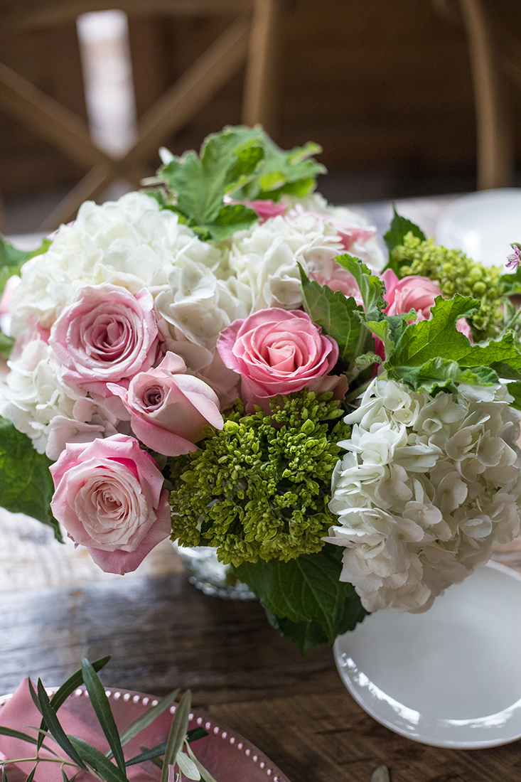 An image of pink roses and white hydrangea floral arrangement for the Farmhouse Garden Party