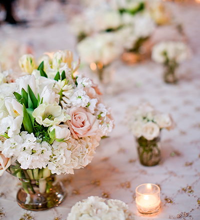 An image of the light pink and white flower floral arrangement at the Lindsay & Shawn Wedding