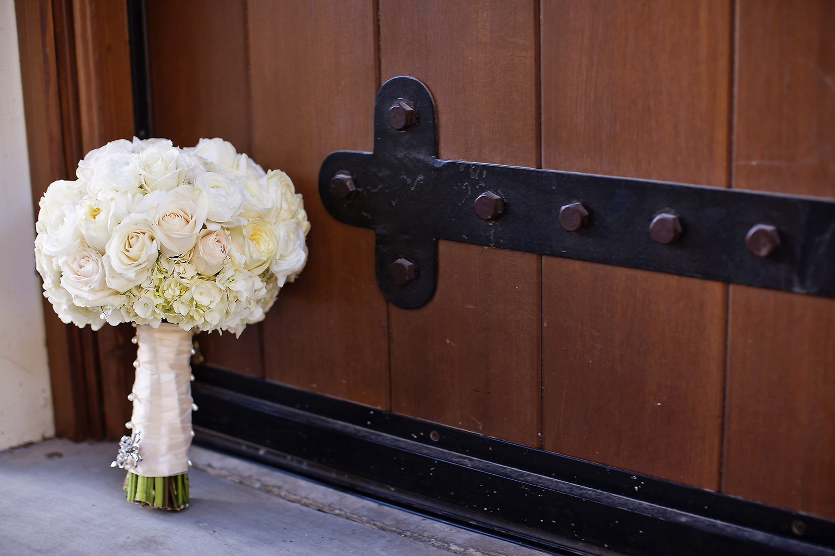 An image of a white rose and hydrangea floral bouquet from the Lindsay & Shawn Wedding