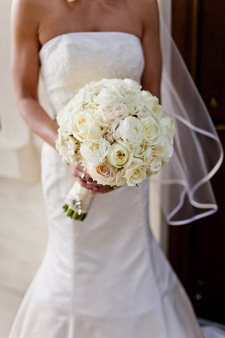 An image of a large white rose bouquet from the Lindsay & Shawn Wedding