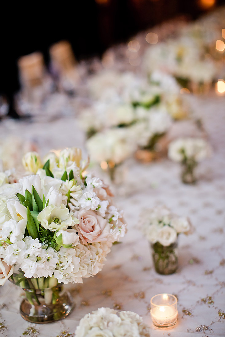 An image of the light pink rose and various white flower floral centerpiece for the Lindsay & Shawn Wedding