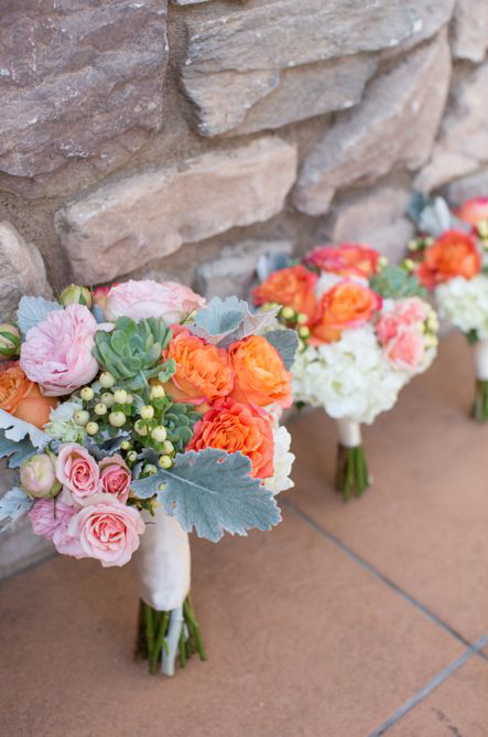 An image of light pink, orange roses floral arrangement from the Cortez