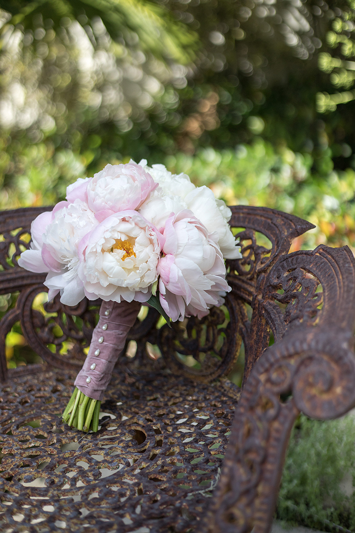 An image of a white and light pink rose bouquet from the Dunzer Wedding