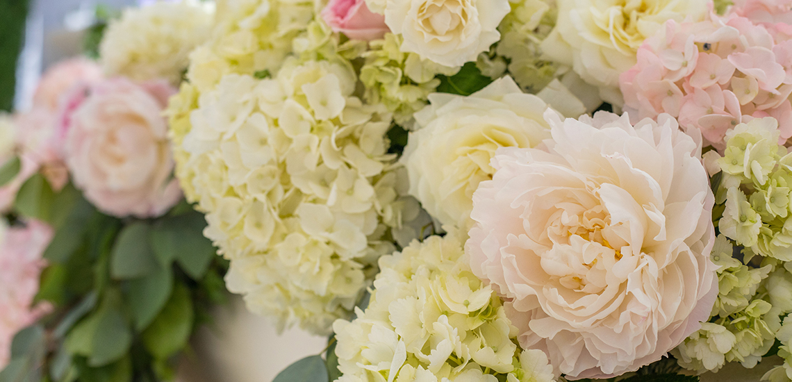 An image of a white hydrangea wedding table placement