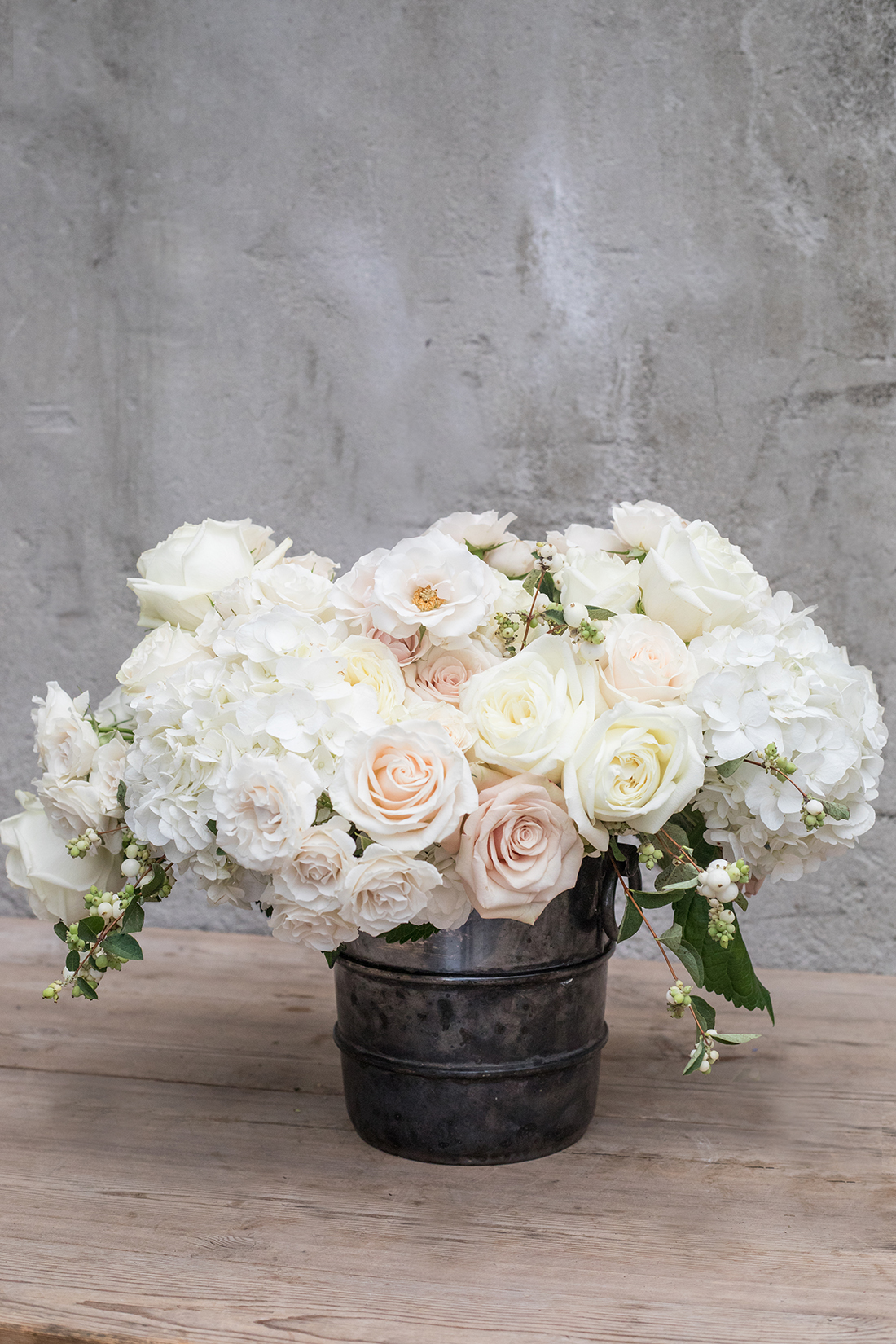 An image of a white rose and hydrangea wedding arrangement