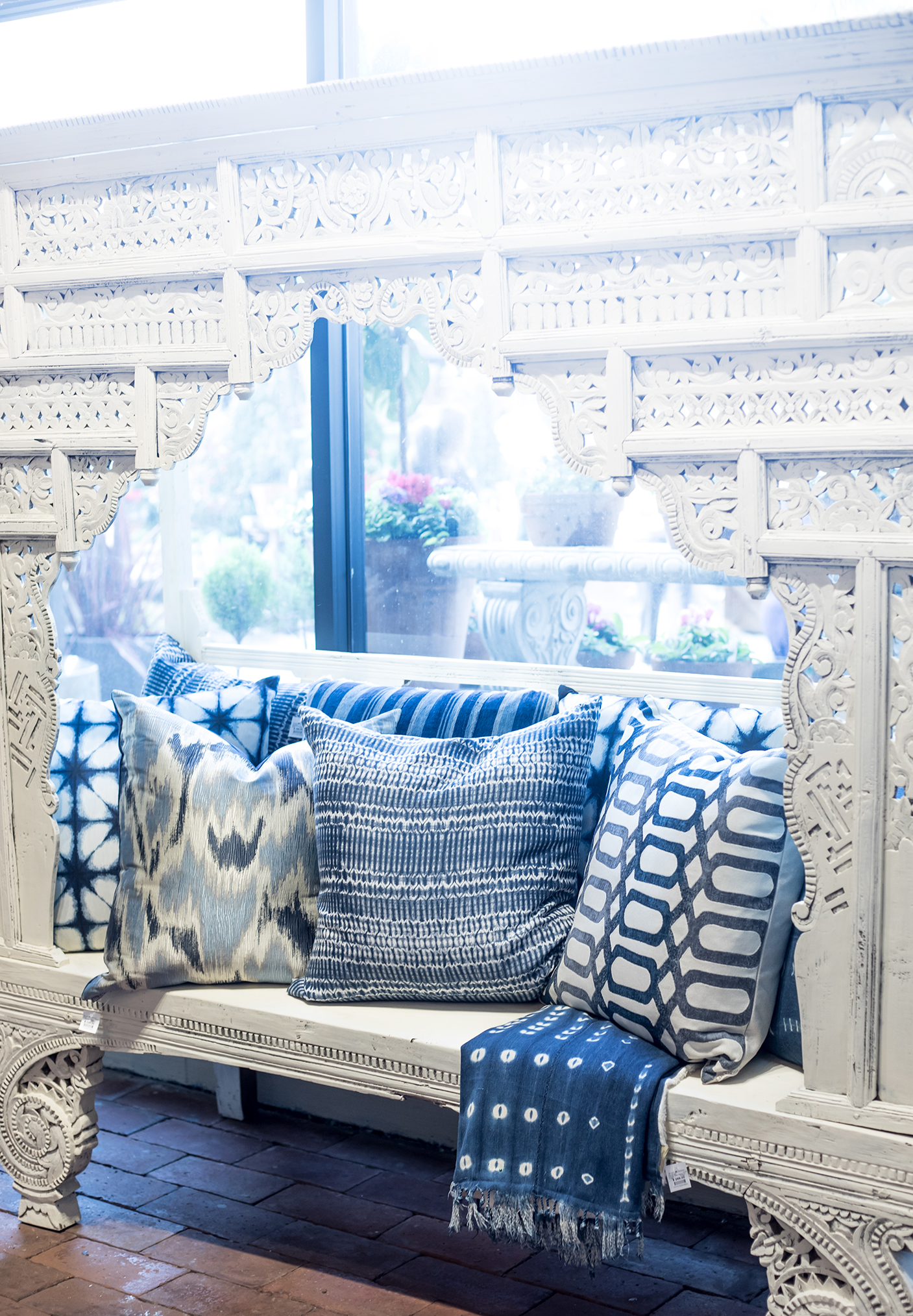 Intricate White Bench with Blue Decor