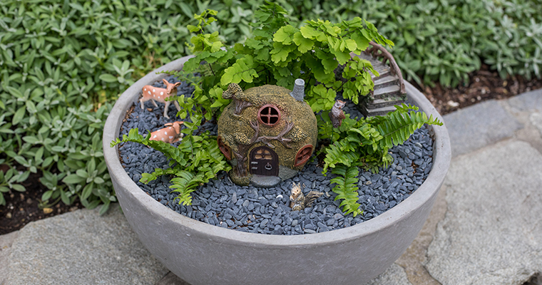 An image of a miniature house, animals and plants for mini garden