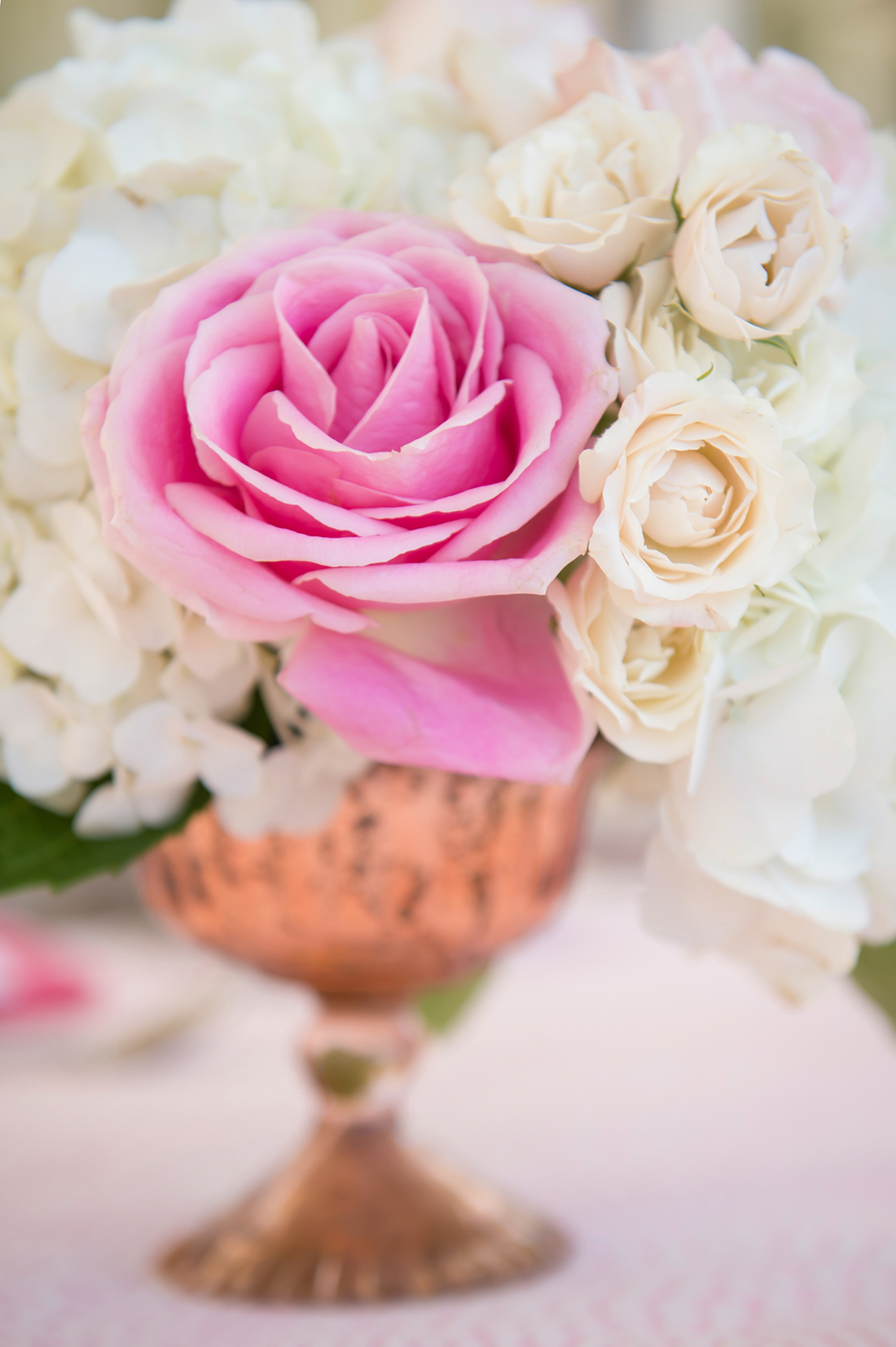 An image of pink and white roses arrangement for something lovely event