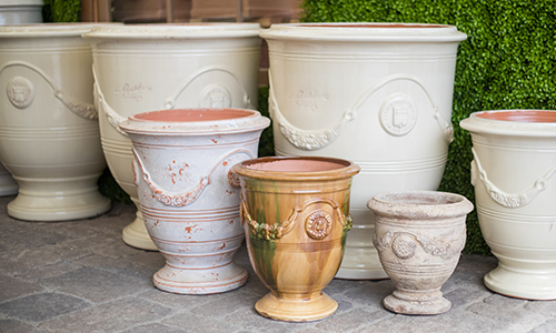 An image of white and orange different size potting pots