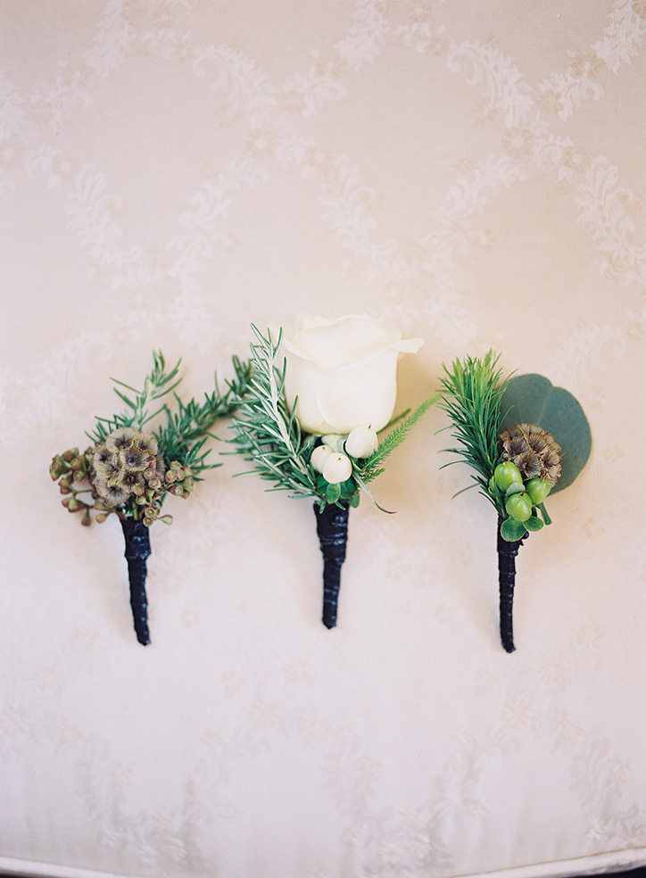 An image of white rose boutonniere