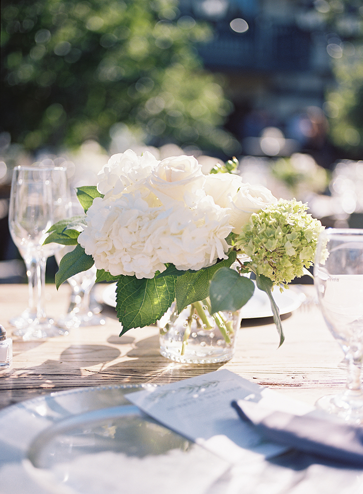 An image of white rose and hydrangea floral centerpiece