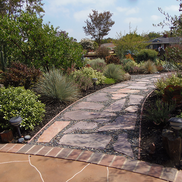 Image of wide stone pathway and cal friendly garden
