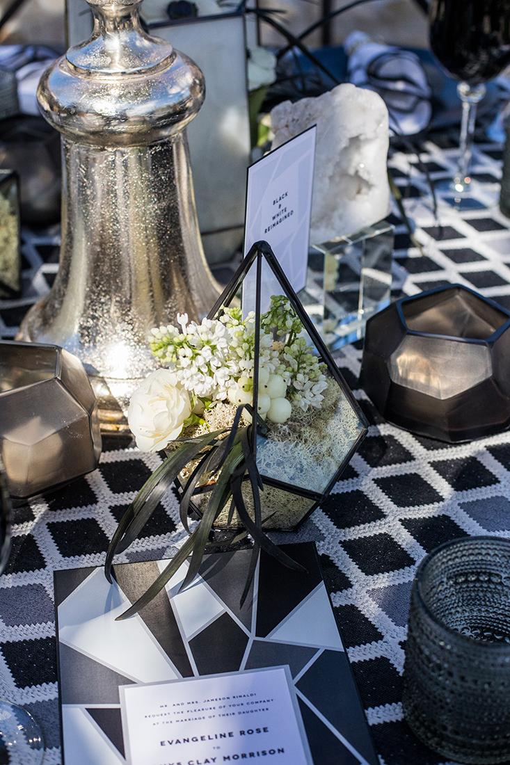 An image of a glass diamond terrarium decorative setting piece