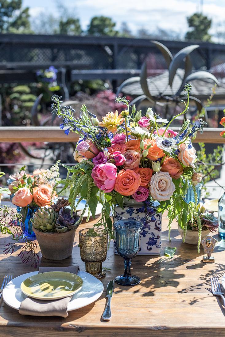 An image of a pink and orange rose boho floral arrangement