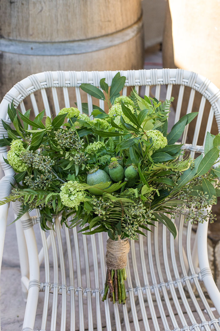 An image of a green floral wedding bouquet