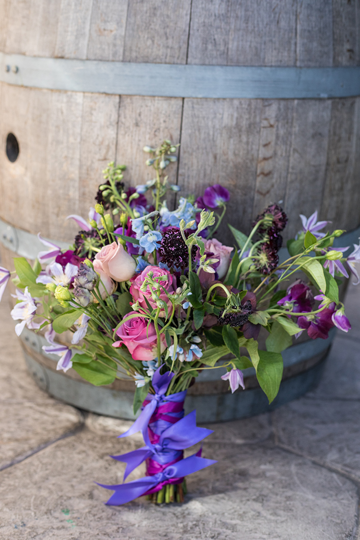 An image of pink, purple and blue flower bouquet