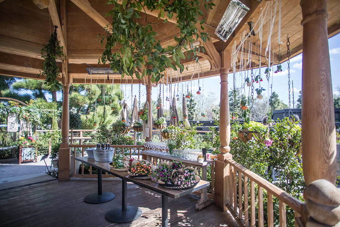 An image of the Gazebo decorated with hanging roses and wreaths