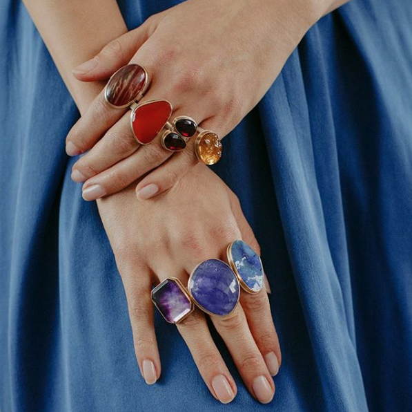 An image of several colored stone and jeweled rings