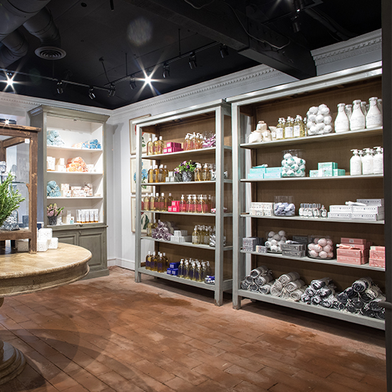 An image of soaps, lotion, towels and bath bombs bath and body boutique