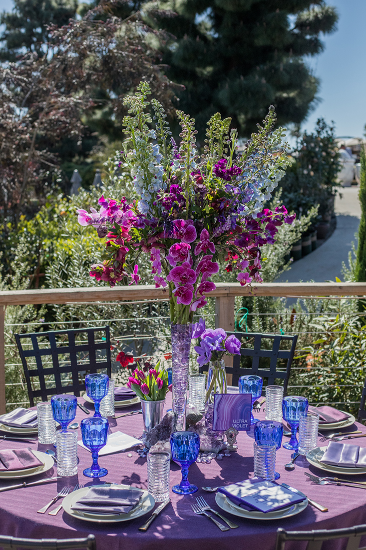 An image of a purple orchid floral arrangement for the ultra violet dining set