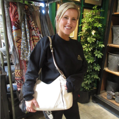 An image of a Roger's Gardens staff member holding a large white purse
