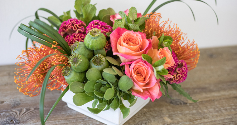 An image of orange pink roses floral arrangement