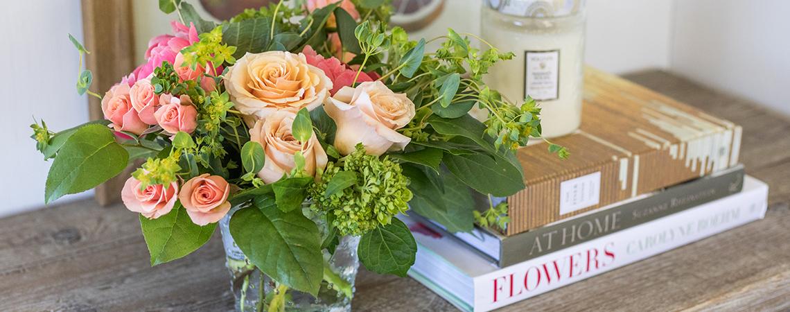 An image of orange rose floral arrangement for Mother's Day