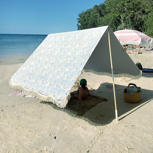 An image of a blue and white patterned tent for the beach