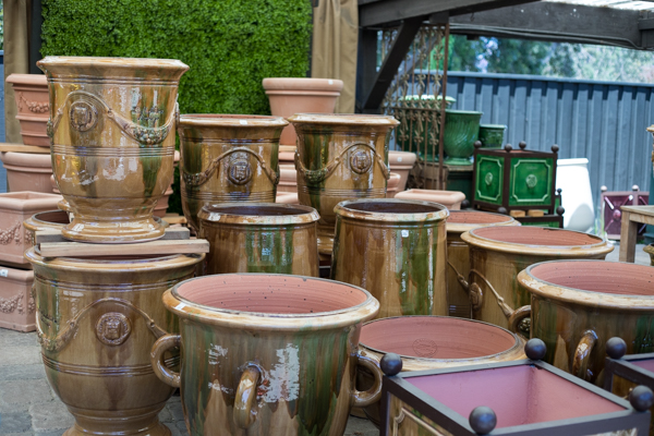 An image of various types of tan and green ceramic pots
