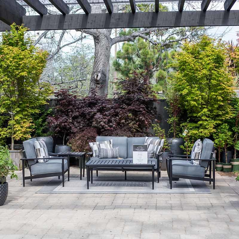 An image of a grey and white outdoor patio set